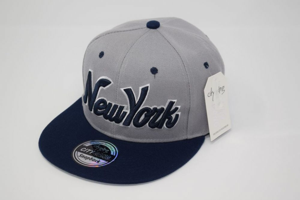 C4874- New York Navy/Gray Snapback Cap one size fits all adjustable 20% cotton, 80% polyster